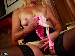 Mature Blonde Plays With Her Hot Pussy